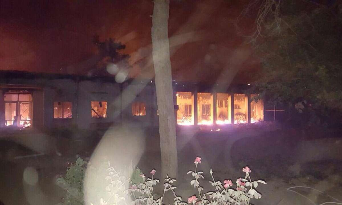 """The Doctors Without Borders hospital is seen in flames, after an explosion in the northern Afghan city of Kunduz, Saturday, Oct. 3, 2015 . Nine local staffers for Doctors Without Borders were killed and 30 were missing after the explosion that may have been caused by a U.S. airstrike. In a statement, the international charity said the """"sustained bombing"""" took place at 2:10 a.m. (2140 GMT). Afghan forces backed by U.S. airstrikes have been fighting to dislodge Taliban insurgents who overran Kunduz on Monday."""