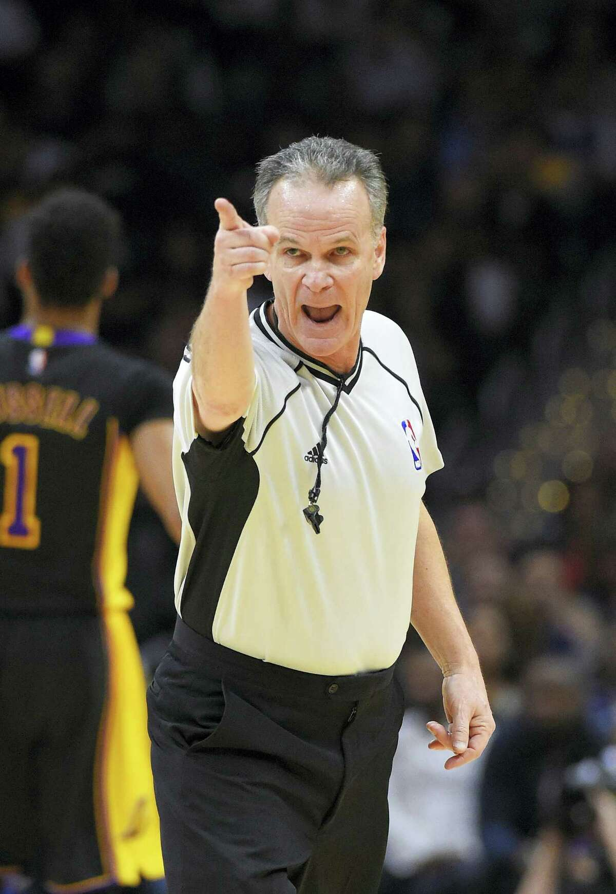 Referee Mike Callahan gestures during the first half of an NBA basketball game between the Los Angeles Clippers and the Los Angeles Lakers Jan. 29 in Los Angeles.