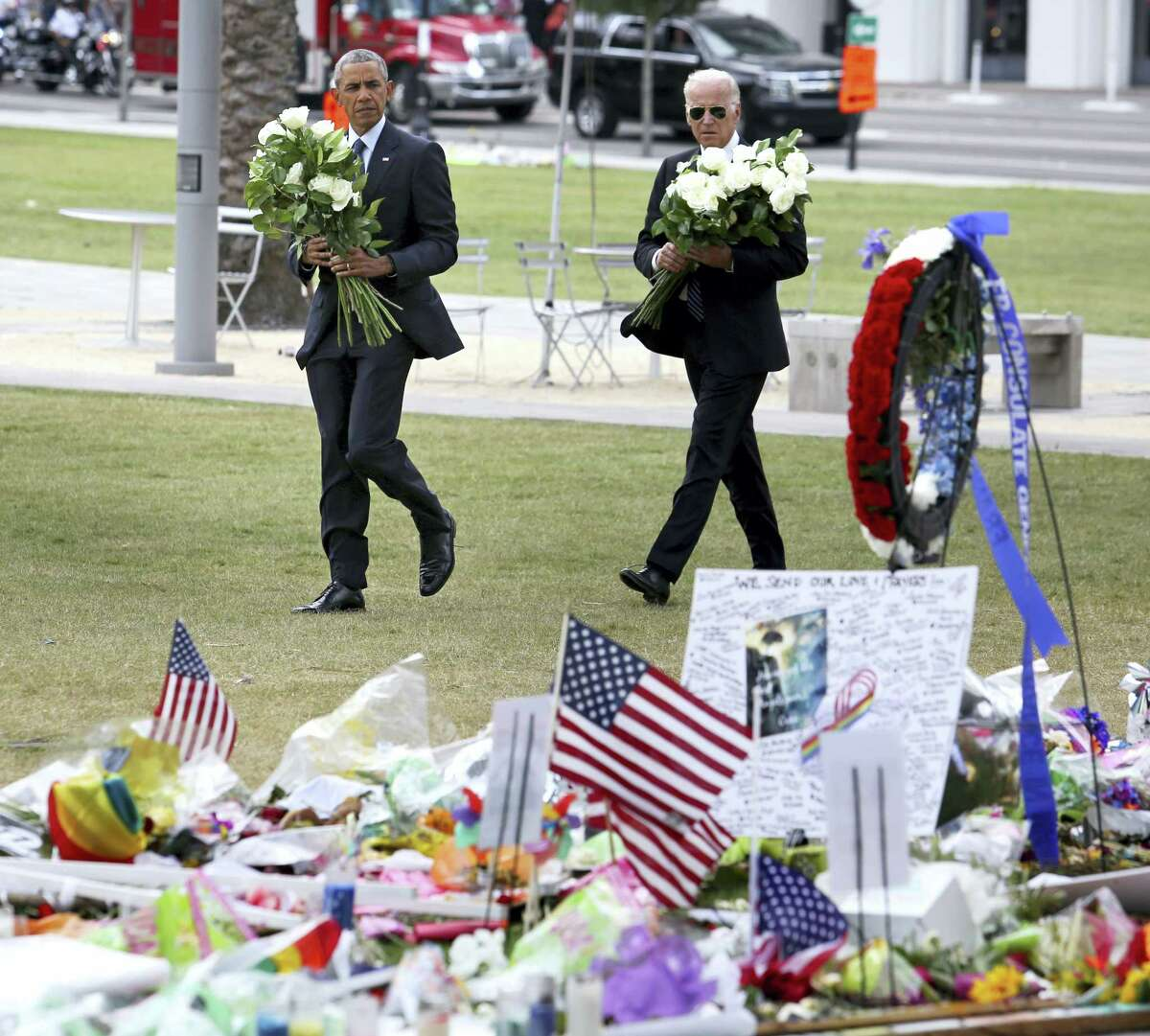 President Barack Obama and Vice President Joe Biden visit a makeshift memorial to the victims of the Pulse nightclub shooting, Thursday, June 16, 2016, in Orlando, Fla.