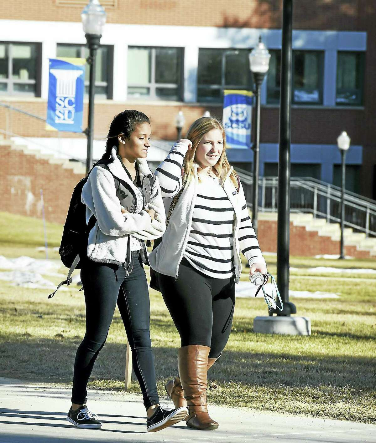 Students walk through the quad at Southern Connecticut State University in New Haven.