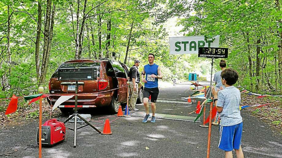 Chris Fernald, 31, of Southington finished in fourth place overall with a time of 23:51 at Saturday afternoon's second annual Wheels and Heels 5K Road Race on Valley Road in Harwinton. Photo: NF Ambery - Register Citizen