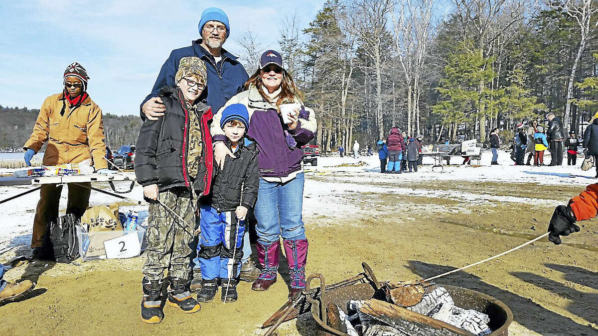 Greg and Lisa Davis of Colchester roasted marshmallows with their sons Luke, 9, and Ryan, 6, at the 10th annual No Child Left Inside Winter Festival on Saturday at Burr Pond State Park at 384 Burr Mountain Road in Torrington.