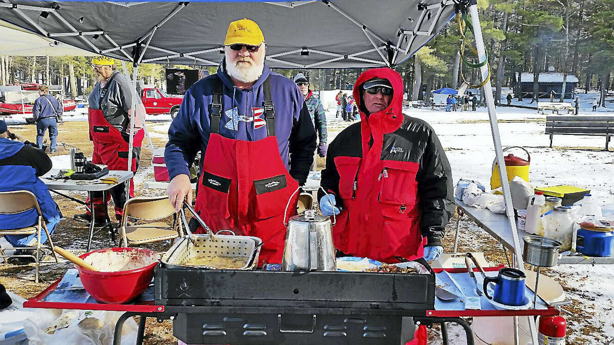 Instructors Tony Recchia and John Delaurentis fried fresh perch at the 10th annual No Child Left Inside Winter Festival on Saturday at Burr Pond State Park at 384 Burr Mountain Road in Torrington.