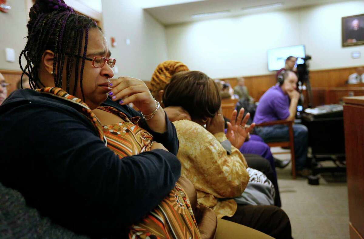 Joanne Paul-Joassainte, left, is tearful during the murder trial for former New England Patriots football player Aaron Hernandez, on Jan. 29, 2015, in Fall River, Mass. Paul-Joassainte was sitting with Lloyd's mother Ursula Ward.