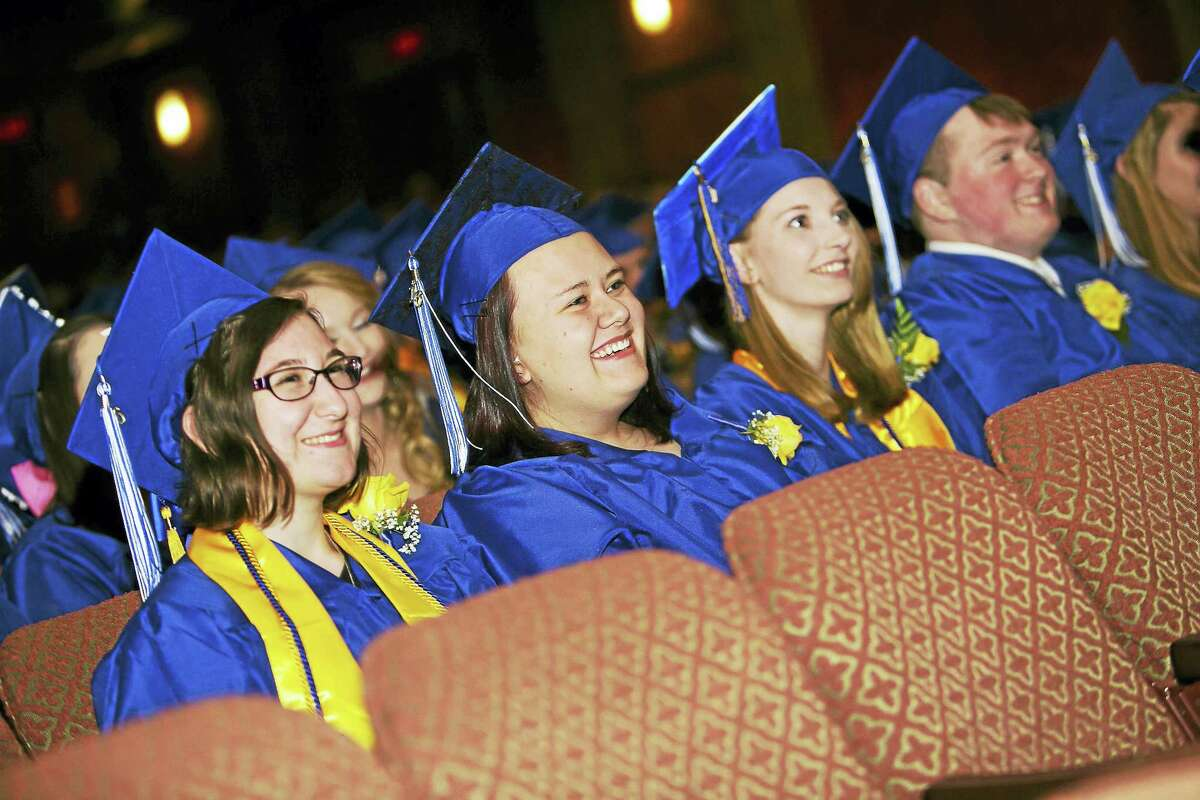 Graduating seniors share a laugh during the ceremony.