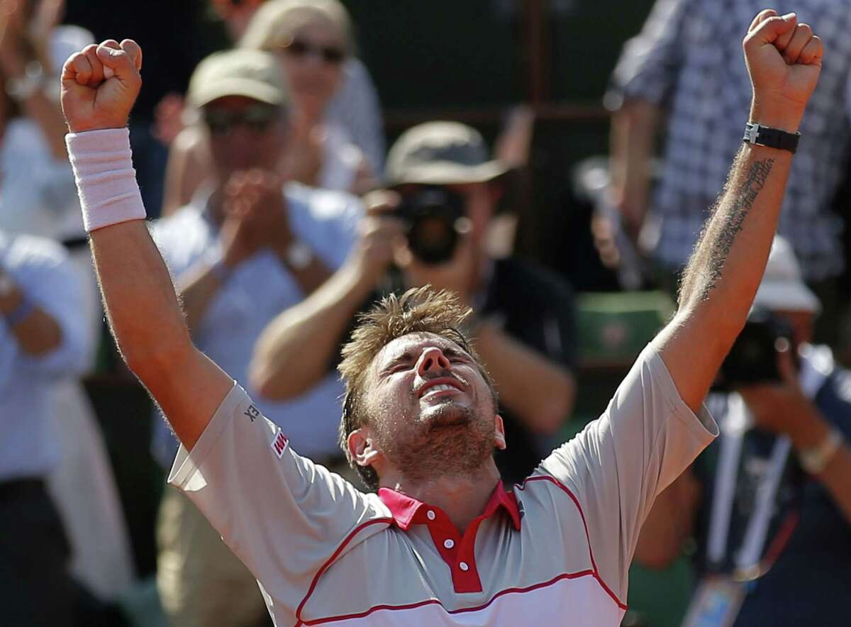 Stan Wawrinka clenches his fists after defeating Jo-Wilfried Tsonga during their semifinal match at the French Open Friday at Roland Garros Stadium in Paris.