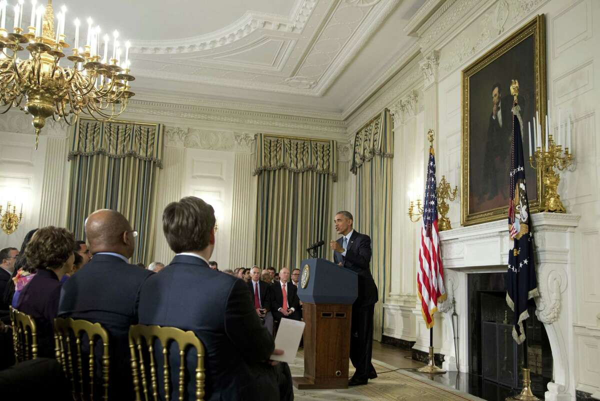 President Barack Obama speaks during a news conference in the State Dining Room of the White House in Washington, Friday, Oct. 2, 2015. President Obama is rejecting Russia's military campaign in Syria, saying it fails to distinguish between terrorist groups and moderate rebel forces with a legitimate interest in a negotiated end to the civil war.
