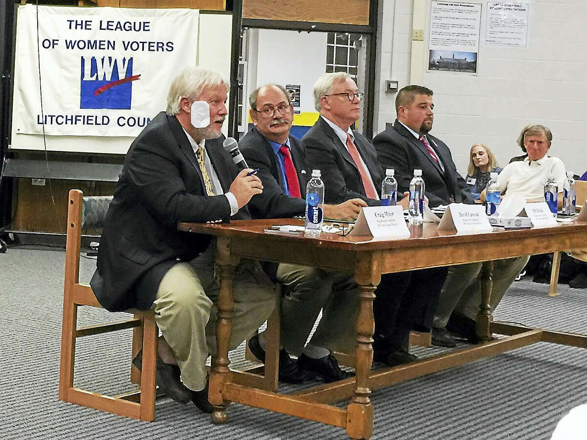 Ben Lambert - The Register Citizen Republican Craig Miner, left, responds to a question during Friday night's debate in Falls Village. Seated from left are candidates David Lawson, Bill Riiska and Brian Ohler.