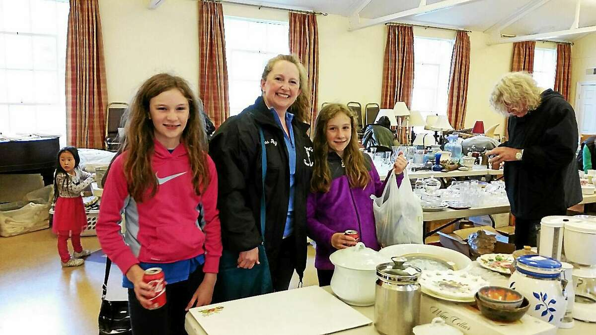 Peggy Terhune and her two daughters Isabelle and Audrey, both 11, of Litchfield attended St. Michael's Village Fair and Tag Sale at St. Michael's Parish at 25 South St. in Litchfield Saturday afternoon.