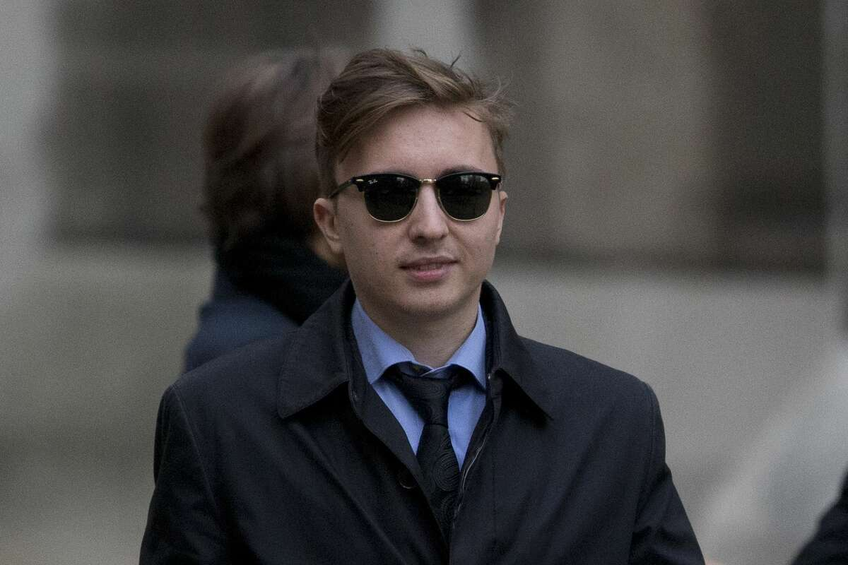 Anatoly Litvinenko, the son of former Russian intelligence officer Alexander Litvinenko, leaves after his mother Marina testified at the inquiry into her husband's death at the Royal Courts of Justice in London, Monday, Feb. 2, 2015. The widow of former KGB officer Alexander Litvinenko described him Monday as a loyal intelligence agent who grew disillusioned with Russia's 1990s war in Chechnya and what he saw as the country's corrupted security services. (AP Photo/Matt Dunham)