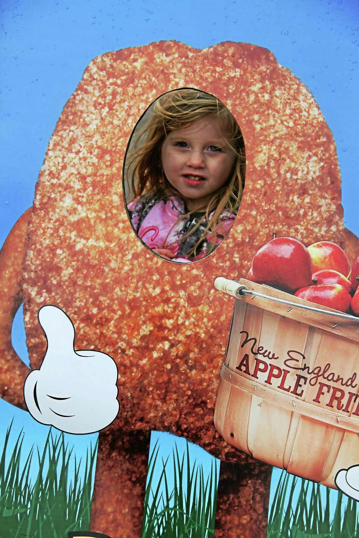 An unidentified child enjoys the fun at the 159th annual Harwinton Fair.