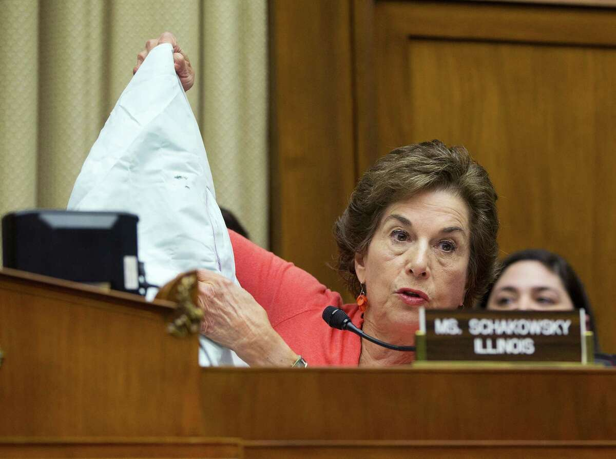 Rep. Jan Schakowsky, D-Ill., holds an auto air bag during a hearing before the House Energy and Commerce Subcommittee on Commerce, Manufacturing and Trade on Capitol Hill in Washington, Tuesday, June 2, 2015. Lawmakers are seeking answers from the maker of defective air bags and federal regulators as they focus on the biggest auto-safety recall in the U.S. history. Japan's Takata Corp. agreed last month to declare 33.8 million air bags defective. Faulty inflators inside the air bags are responsible for six deaths and over 100 injuries worldwide. (AP Photo/Pablo Martinez Monsivais)