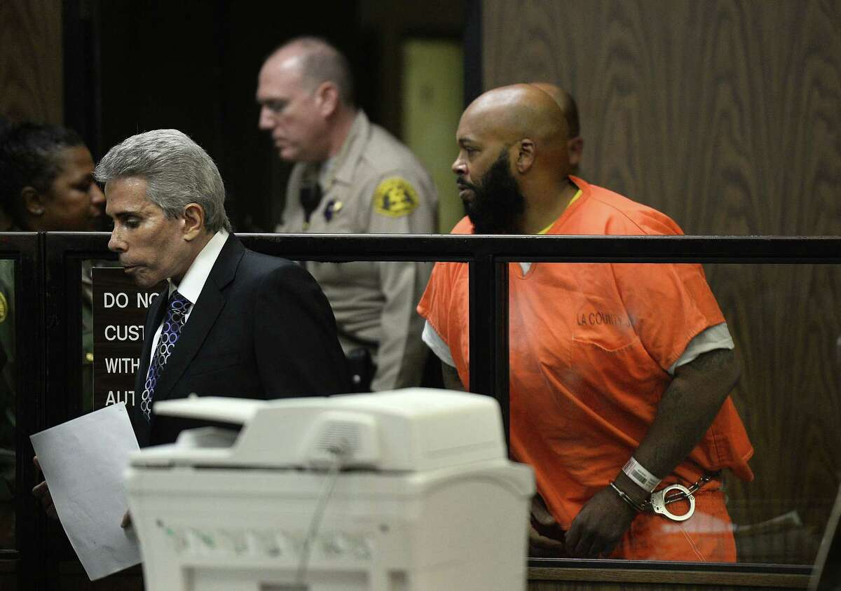 Death Row Records founder Suge Knight, right, leaves a courtroom with his attorney, David Kenner, after his arraignment, Tuesday, Feb. 3, 2015, in Compton, Calif. Knight, 49, pleaded not guilty to murder, attempted murder and other charges after being accused of striking two men with his truck last week. (AP Photo/Paul Buck, Pool)