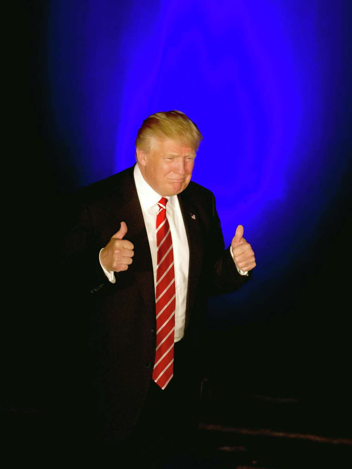 Republican presidential candidate Donald Trump gives a thumbs up as he walks on stage to speak at a rally at the Fox Theater Wednesday in Atlanta.