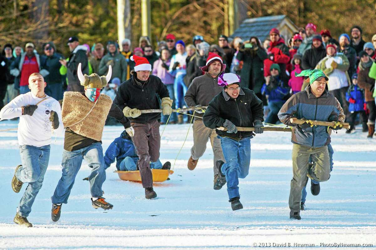 A team competes in the human dogsled competition at Jumpfest in Salisbury in 2014.