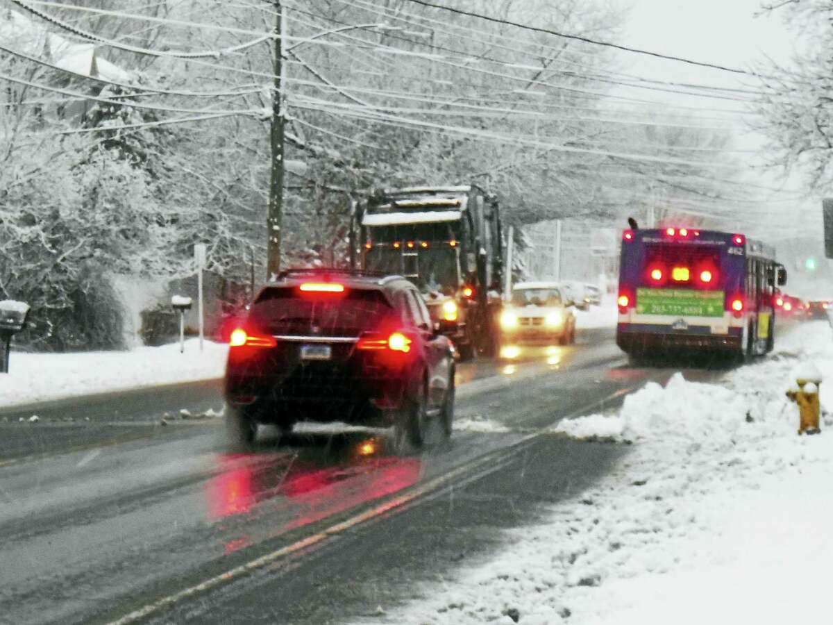 New Haven drivers battled through heavy snow Friday morning on Middletown Avenue in New Haven. The city was expected to receive more than 6 inches of snow from the storm.