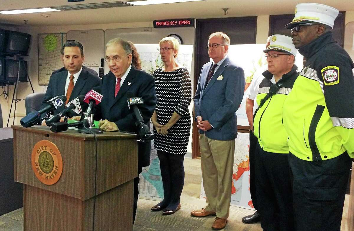 State Senate President Martin Looney speaks Thursday at a news conference about the state's price gouging law. Looney and other lawmakers urged people to report any unfair prices they see following severe weather in the state.