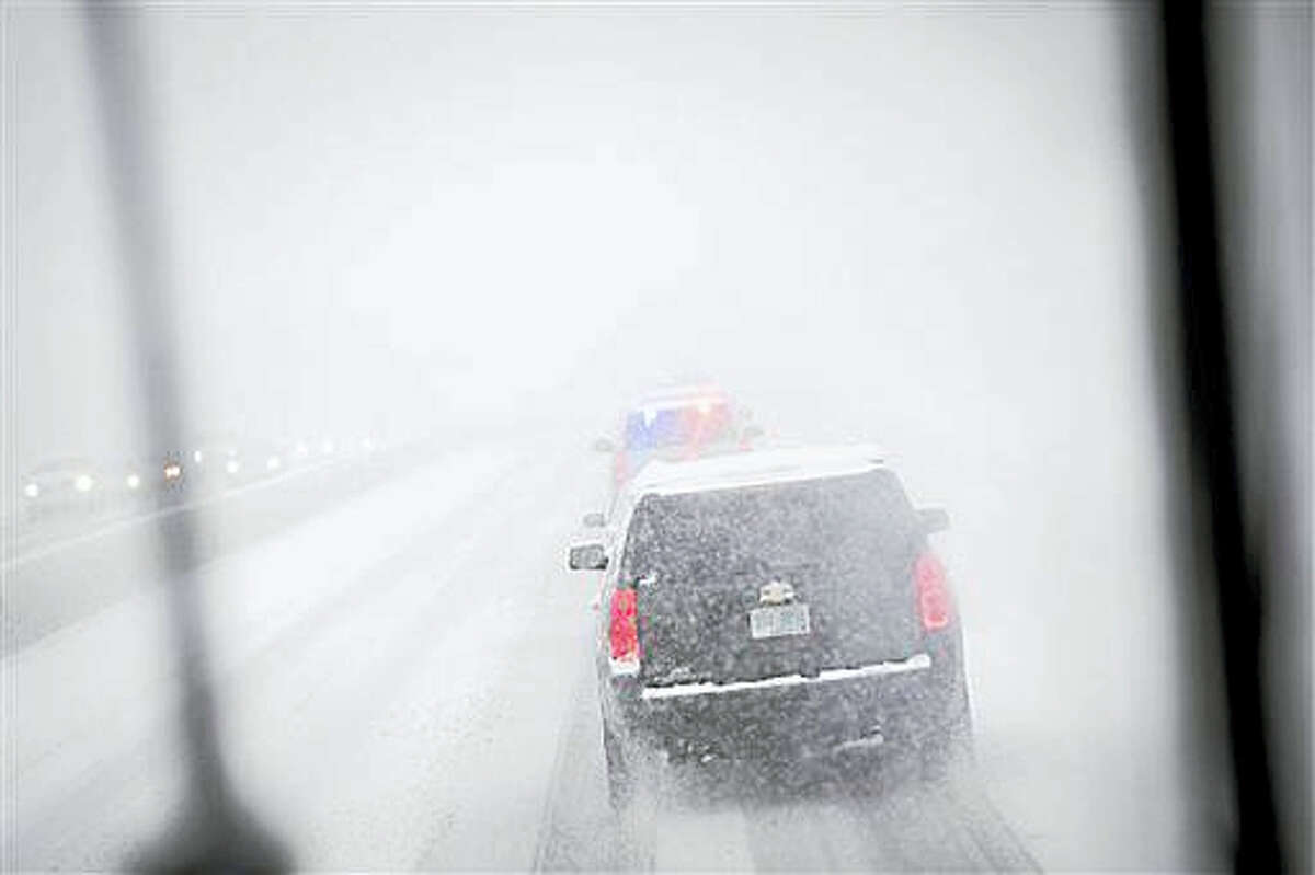 The motorcade of Democratic presidential candidate Sen. Bernie Sanders, I-Vt., drives through a snow storm on Interstate 93, Friday, Feb. 5, 2016, in Manchester, N.H. What started off as rain Friday morning quickly turned to sticky, heavy snow. Many school districts in the region closed for the day, including in some in Massachusetts, New Hampshire and Rhode Island.