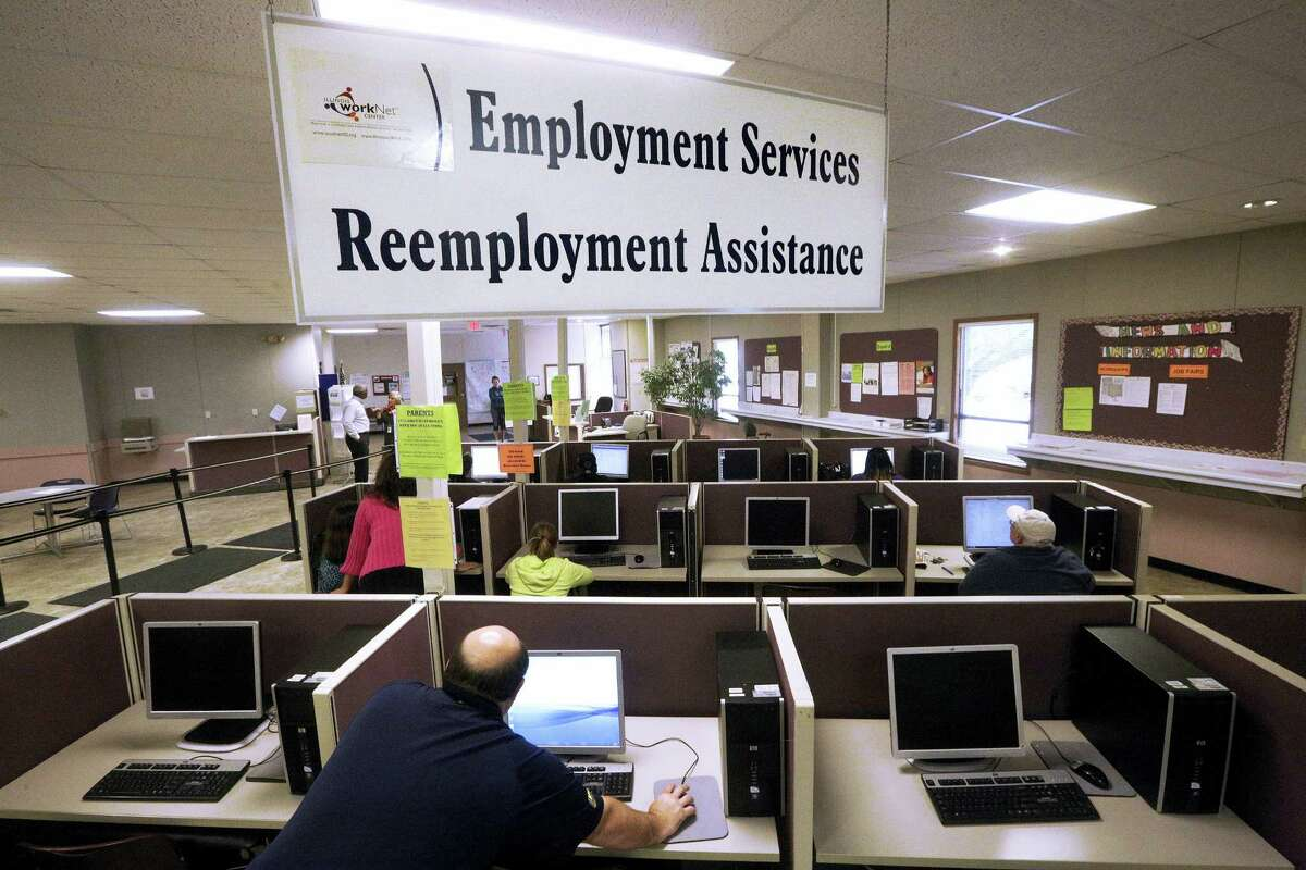 This Thursday, Sept. 29, 2016, file photo, shows the Illinois Department of Employment Security office in Springfield, Ill. On Thursday, Oct. 20, 2016, the Labor Department reports on the number of people who applied for unemployment benefits the week before.