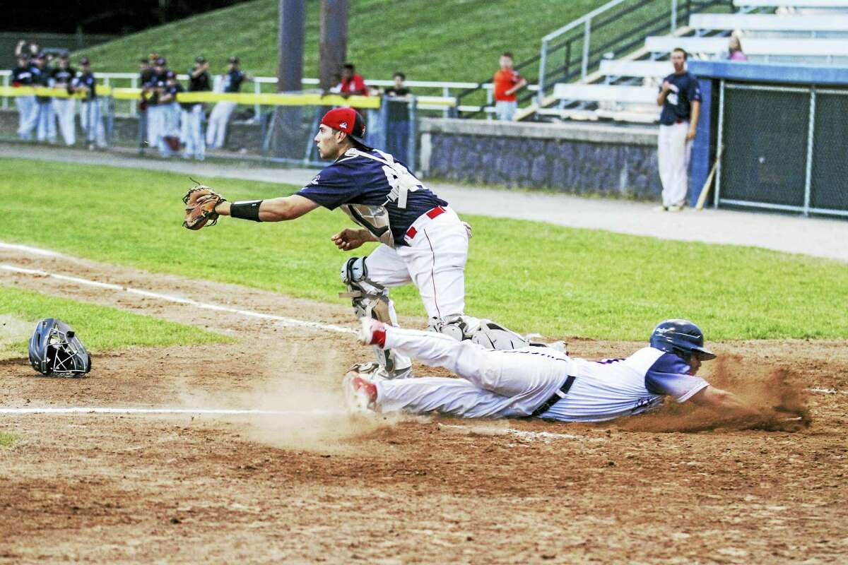 Photo by Marianne KillackeyTorrington Titan Nick Lamberti, scoring here on a Dirt Dawg error, was part of the improved on-field chemistry for the Titans Wednesday evening
