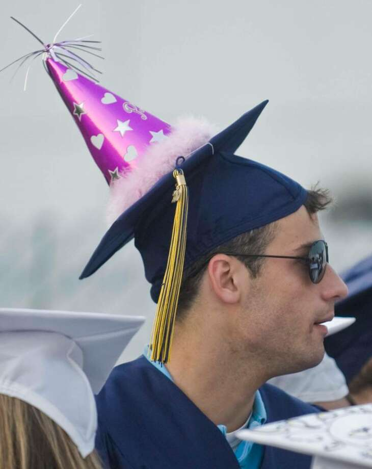 Devone Champagne added a cap decoration during the Brookfield High School graduation at the O'Neil Center. Saturday, June 19, 2010 Photo: Scott Mullin / The News-Times Freelance