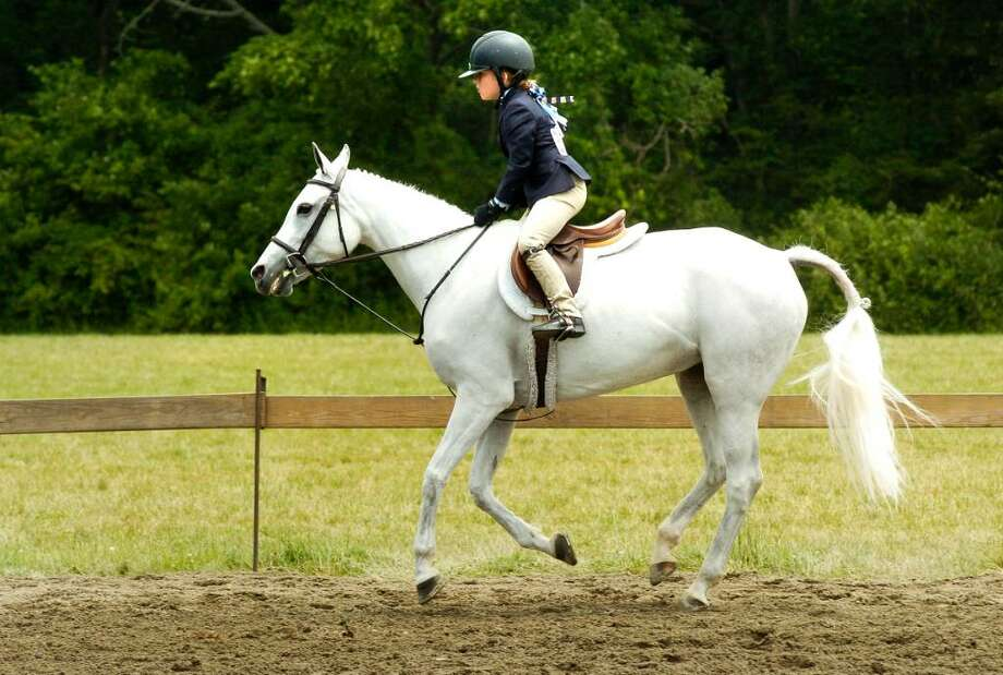 """Avery Bowling , 7, of New Canaan competes on her horse """"Bella"""" during the final day of the Ox Ridge Horse show in Darien, Conn. on Sunday June 20, 2010. Photo: Dru Nadler / Stamford Advocate"""