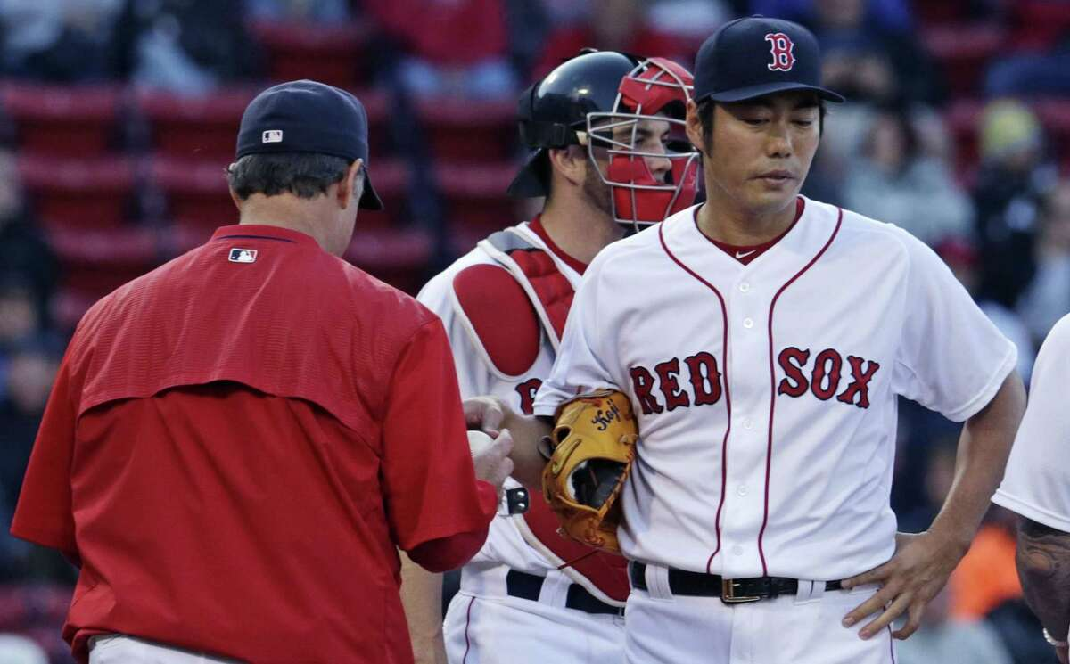 Red Sox closer Koji Uehara hands the baseball to manager John Farrell as he is taken out in the ninth inning on Thursday.