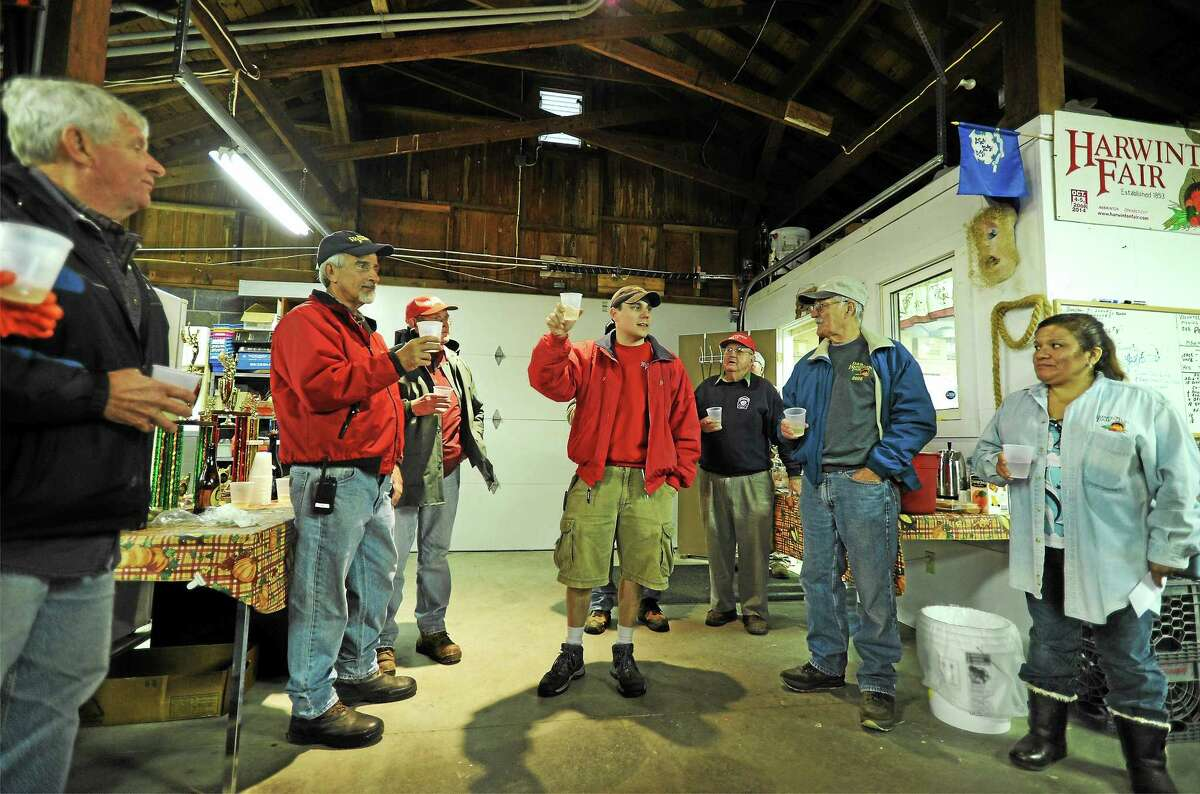 Phil Galullo, vice president of the Harwinton Agricultural Society, leads the traditional cider toast that kicks off the fair. Several past presidents of the society participate in the toast.