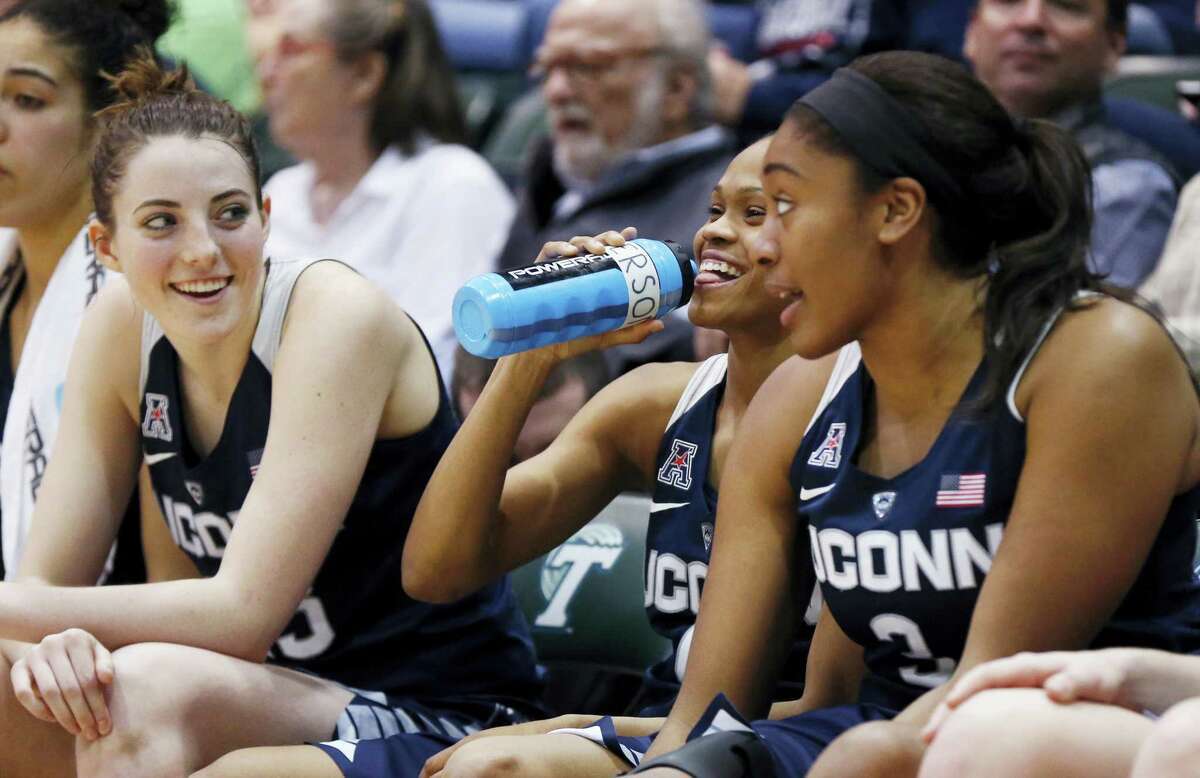 Connecticut guard/forward Katie Lou Samuelson, left, guard Moriah Jefferson and forward De'Janae Boykin share a laugh on the bench in the second half against Tulane in New Orleans, Wednesday. Connecticut won 96-38.