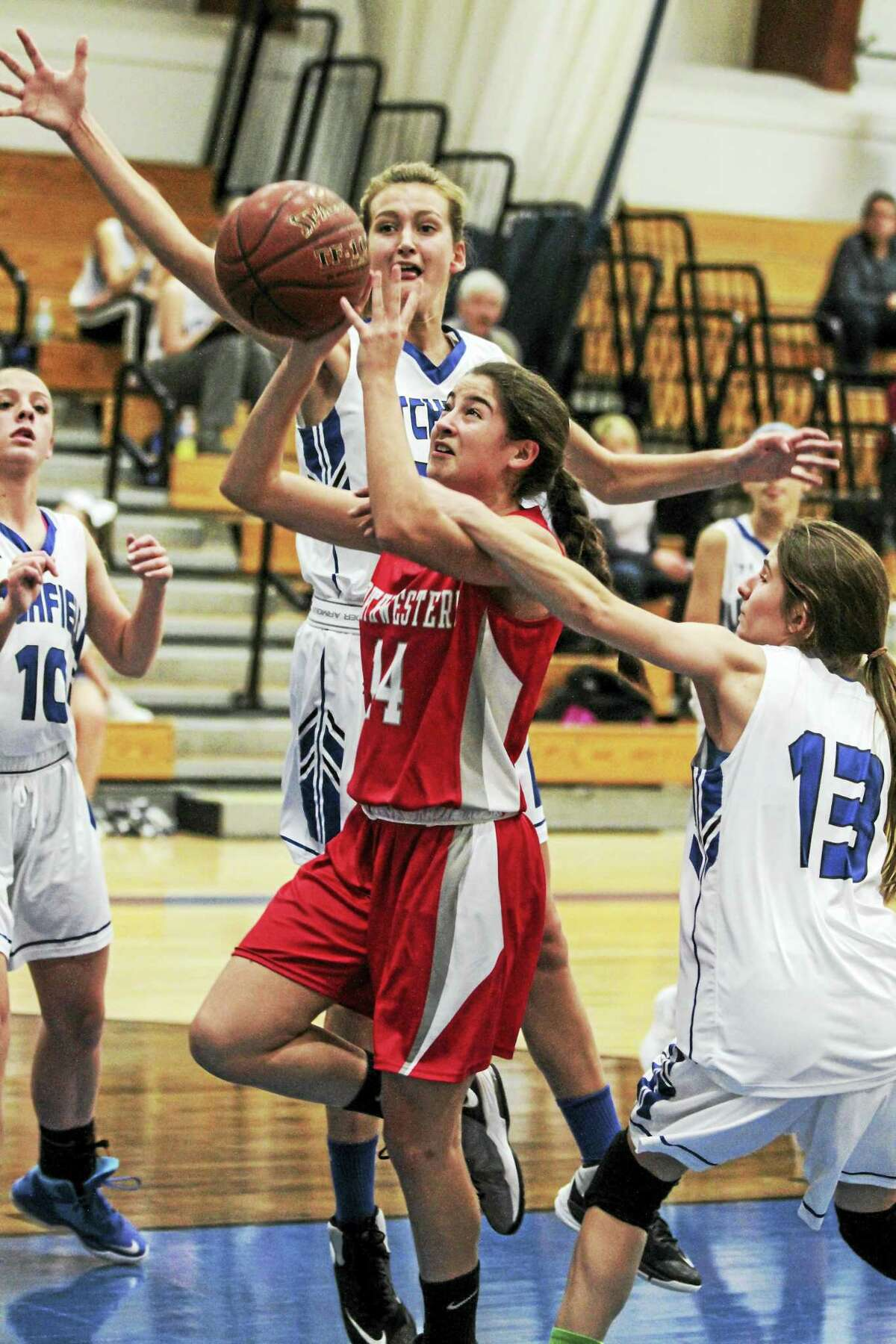 Northwestern sophomore Addie Hester finds a rough welcome in the paint in Thursday's Litchfield win.