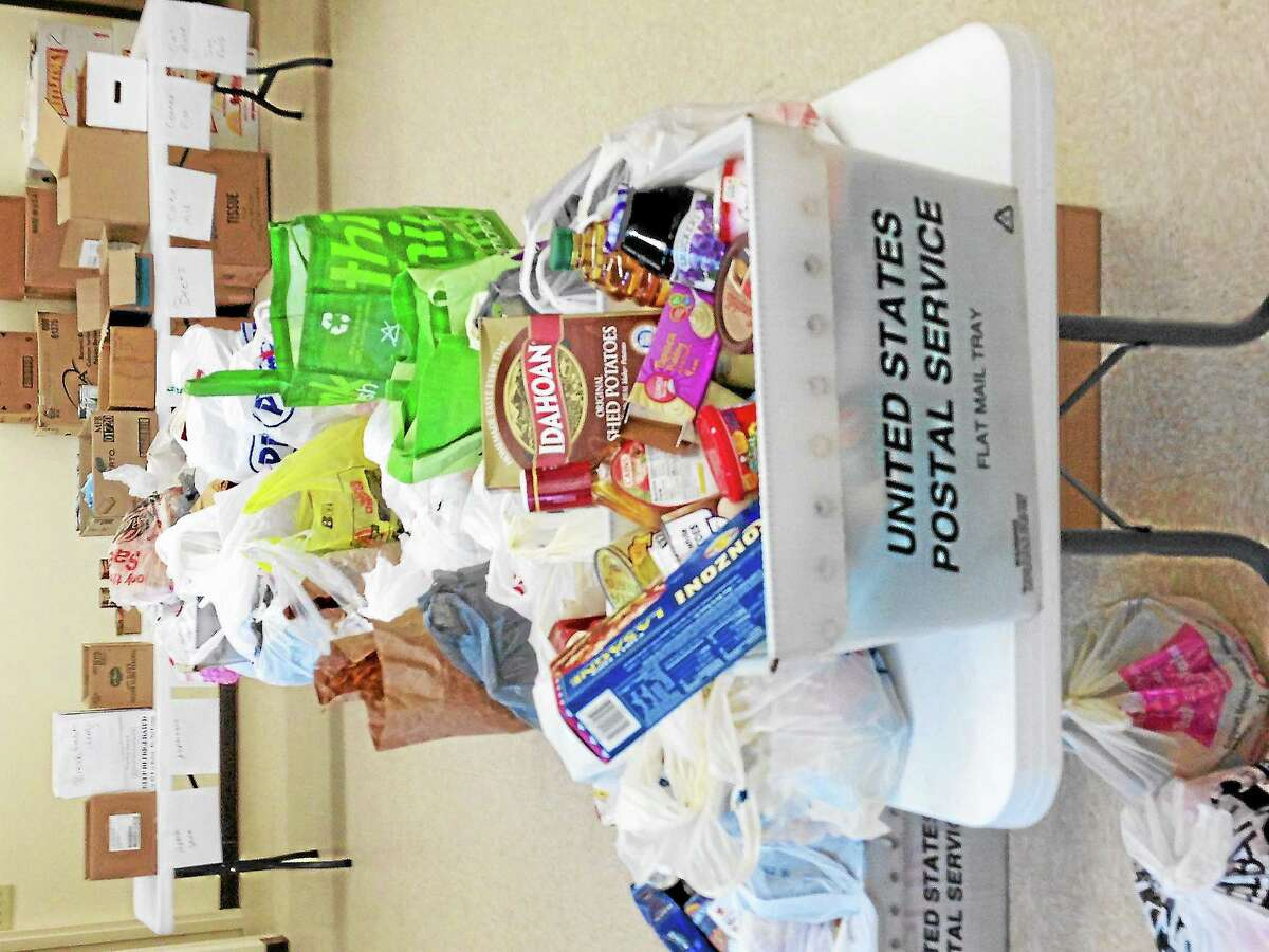 A basket of donated food collected during the National Association of Letter Carriers Food Drive.
