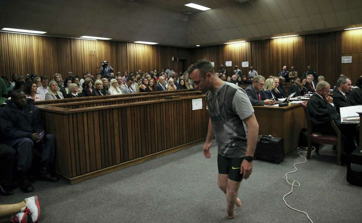 Oscar Pistorius, walks on his stumps during argument in mitigation of sentence by his defense attorney Barry Roux in the High Court in Pretoria, South Africa, Wednesday, June 15, 2016. An appeals court found Pistorius guilty of murder and not a lesser charge of culpable homicide for the shooting death of his girlfriend Reeva Steenkamp.