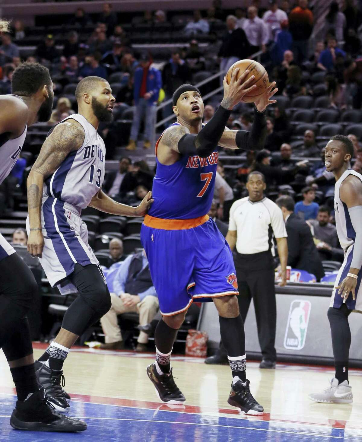 New York Knicks forward Carmelo Anthony (7) makes a layup while defended by Detroit Pistons forward Marcus Morris during the second half Thursday in Auburn Hills, Mich.