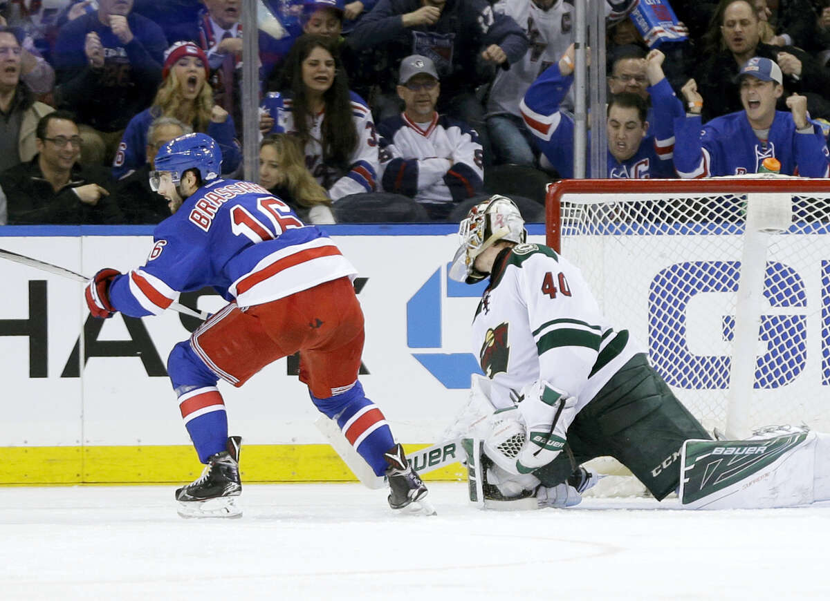 New York Rangers center Derick Brassard (16), left, reacts after scoring the go-ahead goal past Minnesota Wild goalie Devan Dubnyk (40) during the third period of the NHL hockey game, Thursday, Feb. 4, 2016, in New York. The Rangers defeated the Wild 4-2.