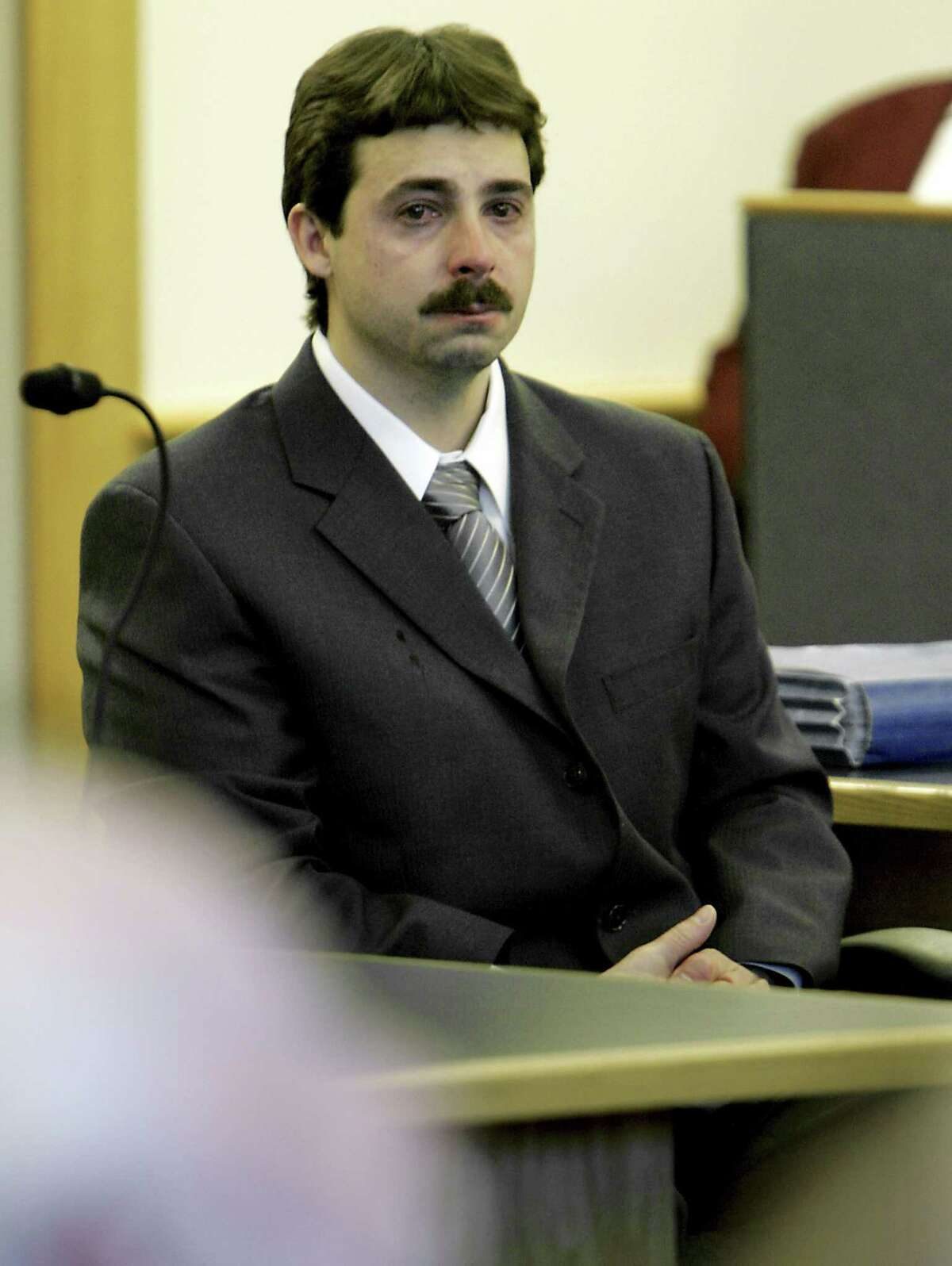 """FILE - In this Jan. 25, 2008 file photo, William """"Billy"""" Flynn, sits in Rockingham Superior Court in Brentwood, N.H. Flynn was convicted and sent to prison for killing Gregg Smart, the husband of his lover, Pamela Smart, in Derry, N.H., in 1990. Flynn was released from prison in Maine on parole Thursday, June 4, 2015 after serving nearly 25 years. (AP Photo/Cheryl Senter, Pool, File)"""