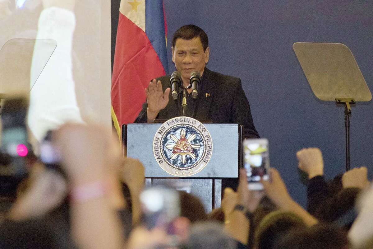 Philippine President Rodrigo Duterte addresses members of the Philippine community in Beijing, China, Wednesday, Oct. 19, 2016. Duterte's effusive message of friendship on his visit to Beijing this week has handed China a public relations bonanza just three months after Beijing suffered a humiliating defeat by an international tribunal.