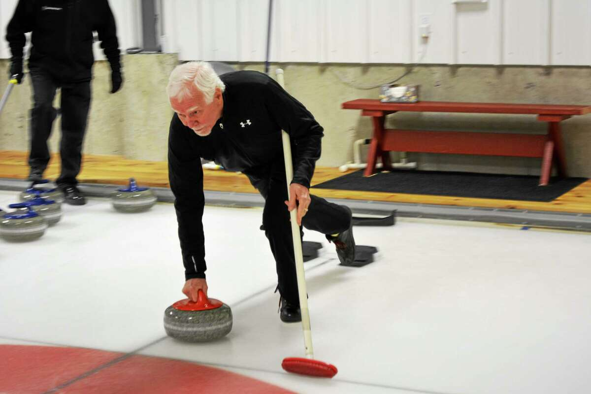 Curling teams from Ardsley, New York, and Cape Cod compete on the ice in Norfolk Friday afternoon.