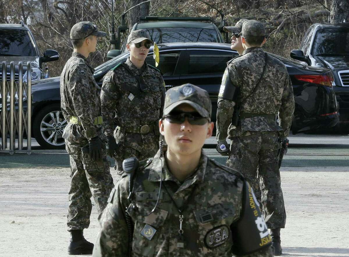 South Korean army soldiers stand guard at Taesungdong freedom village near the border village of Panmunjom in Paju, South Korea, Thursday, Feb. 4, 2016. South Korea and Japan vowed to shoot down any debris that falls on their territories from a long-range rocket that North Korea plans to fire this month, with Seoul saying Thursday that it has detected launch preparations by Pyongyang.