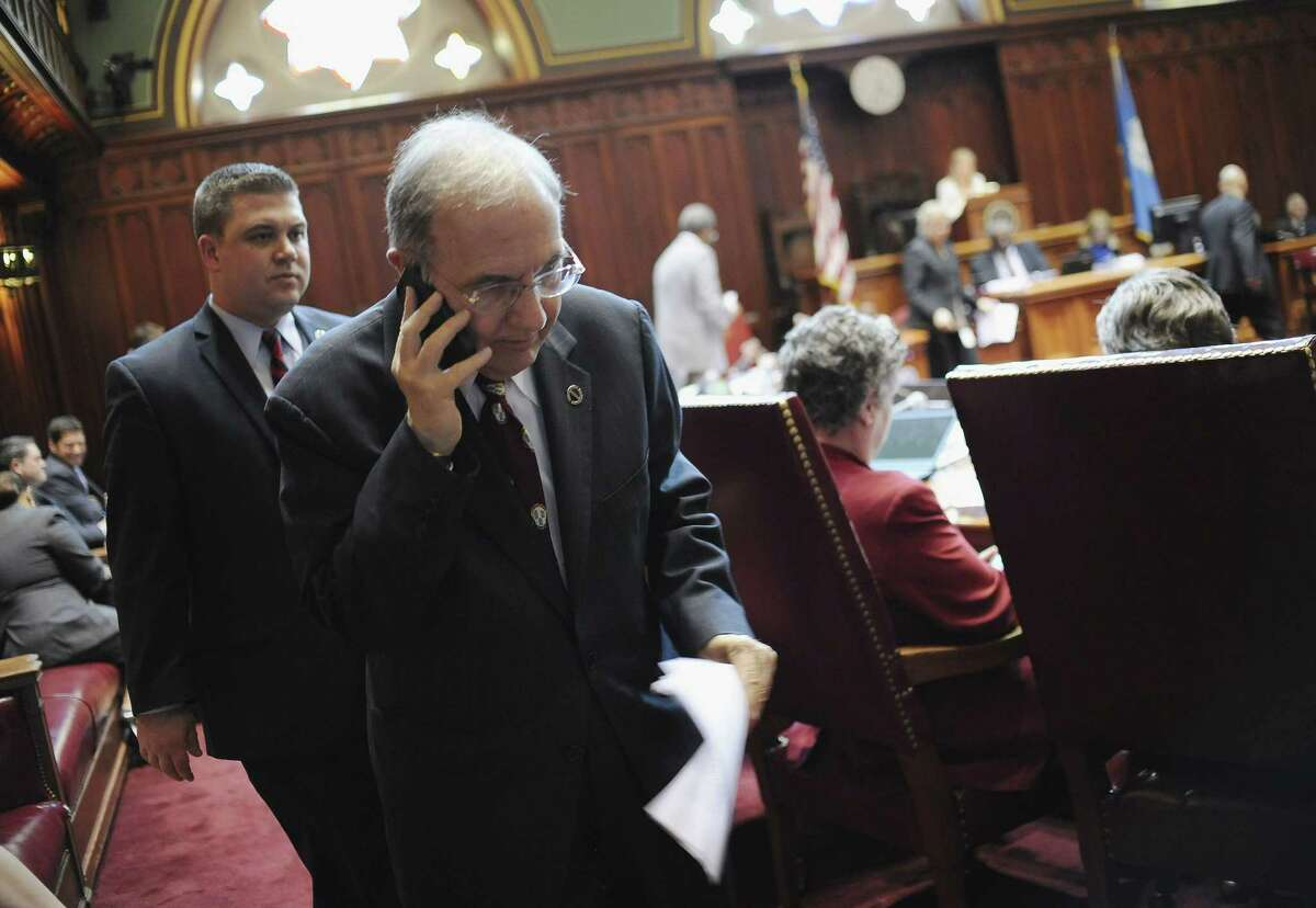 Connecticut State Senate President Martin Looney takes a phone call in Senate Chambers at the Capitol on the final day of session Wednesday in Hartford.