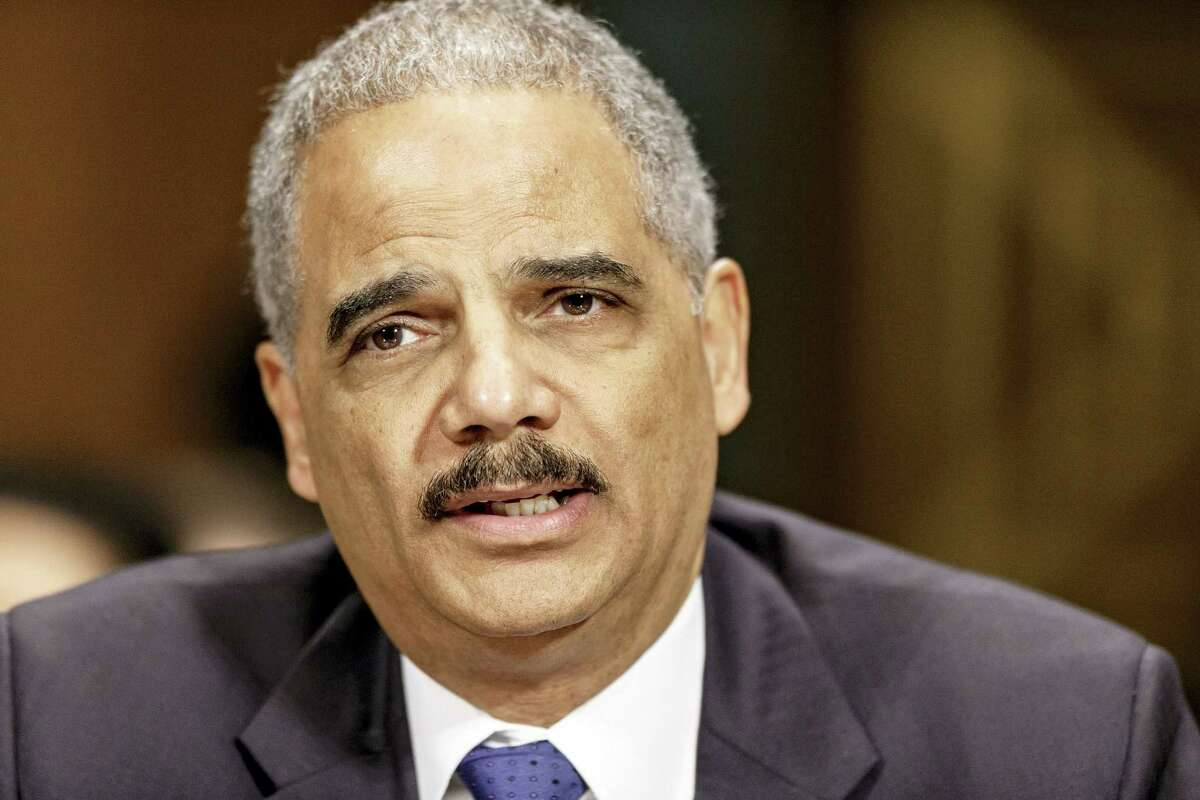 In this Jan. 29, 2014 photo, Attorney General Eric Holder testifies on Capitol Hill in Washington.