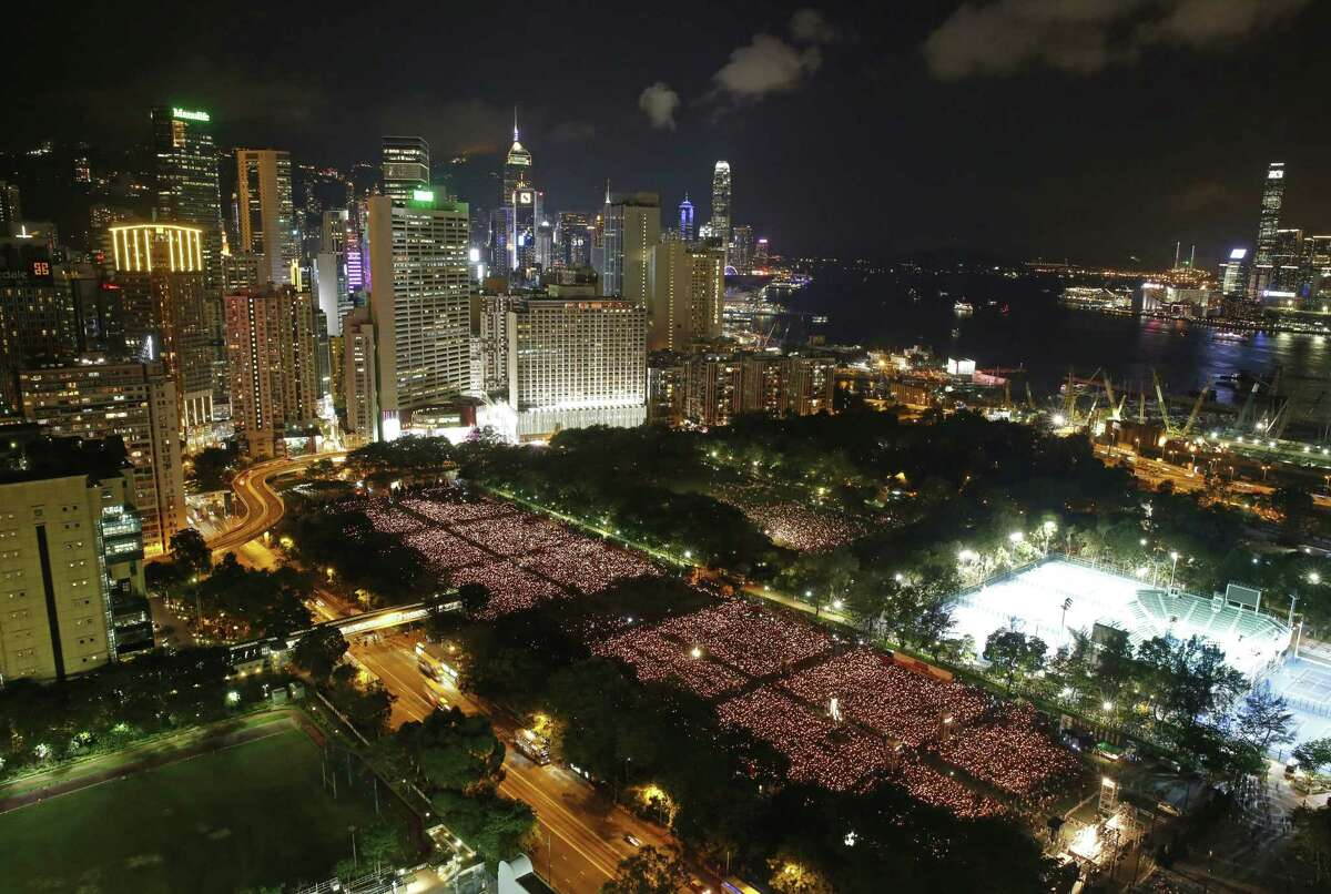 Tens of thousands of people attend a candlelight vigil at Victoria Park in Hong Kong, Thursday, June 4, 2015. Hong Kongers held a candlelight vigil Thursday night to mark the suppression of the 1989 student-led Tiananmen Square protests, an annual event that takes on greater meaning for the city's youth after last autumn's pro-democracy demonstrations sharpened their sense of unease with Beijing. (AP Photo/Kin Cheung)