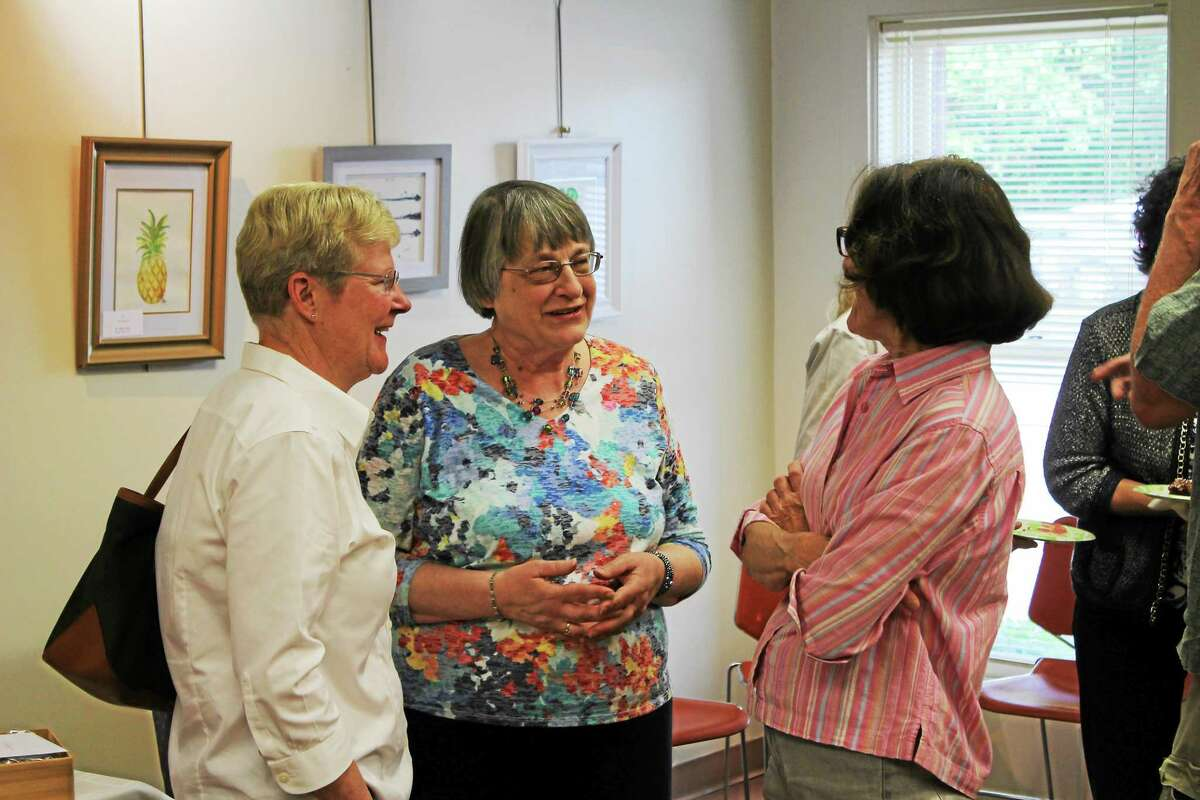 Harwinton Public Library Director Stasia Motuzick, who is retiring, speaks to well-wishers at Wednesday's event.