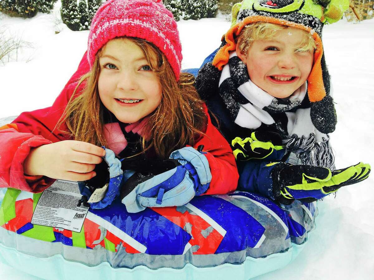 Eliza and Spencer Criss of Harwinton enjoy a snow day on Monday.