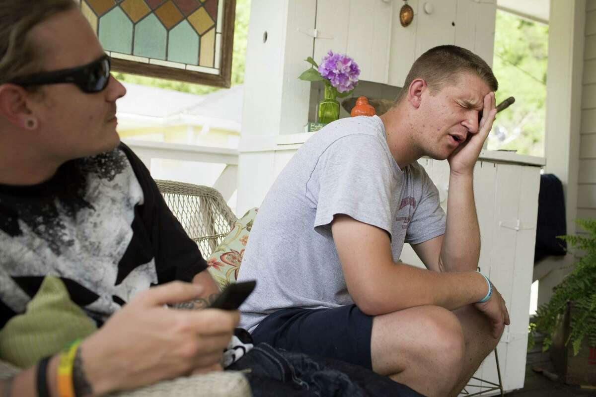 In this May 26, 2015, photo, Patton Couch, who says he was diagnosed with Hepatitis C, talks about his past struggles with using drugs at his home where he lives with his parents in Hazard, Ky. Couch and friend Justin Kennedy, left, are both recovering injection drug users. Public health officials warn that if the region doesn't get the IV drug abuse problem under control, it's likely to see a Hepatitis C or HIV outbreak. (AP Photo/David Stephenson)