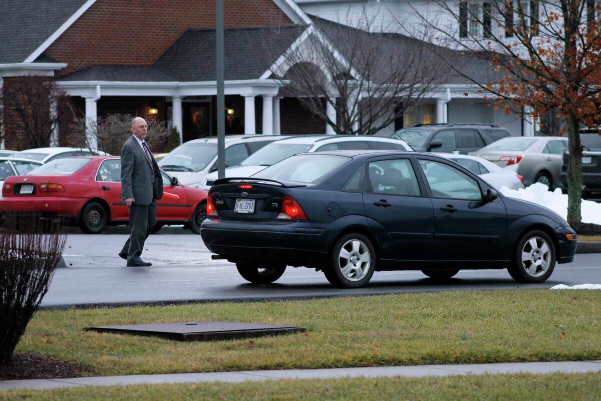 A worker directs traffic in the parking lot of a Blacksburg, Virginia, funeral home on Wednesday, Feb. 3, 2016. McCoy Funeral Home hosted visitation for 13-year-old Nicole Lovell, who authorities say was stabbed to death after she disappeared from her home. Her body was found in North Carolina, and two Virginia Tech students are charged in her death.