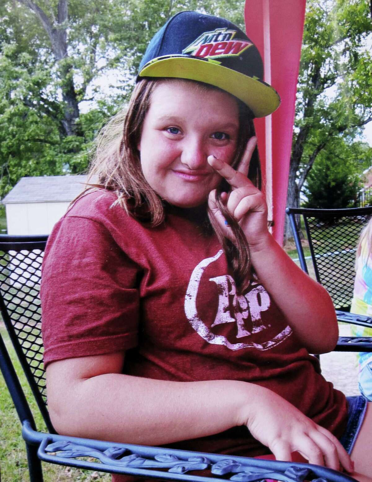 Tammy Weeks via AP In this 2015 photo provided by Tammy Weeks, her daughter, Nicole Lovell, flashes a peace sign in Blacksburg, Va. The 13-year-old girl was found dead just across the state line in Surry County, N.C., and two Virginia Tech students are charged in the case.