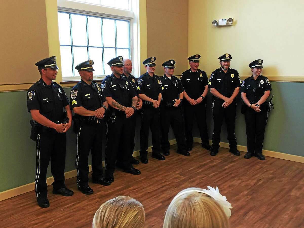 The police officers in attendance that were awarded medals Thursday evening at a meeting of the Board of Public Safety.