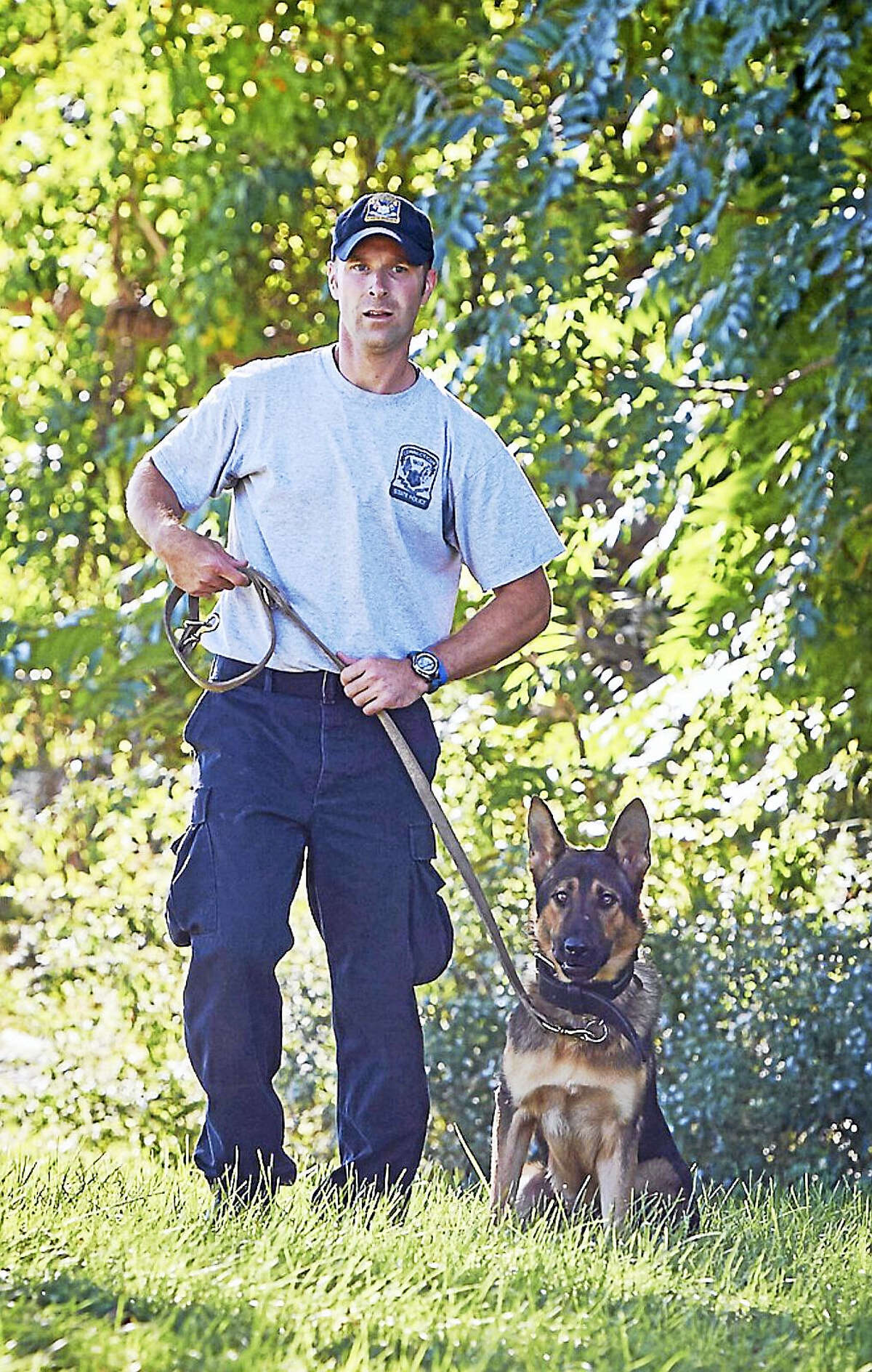K-9 Tobi works with State Trooper Bruce LaChance.