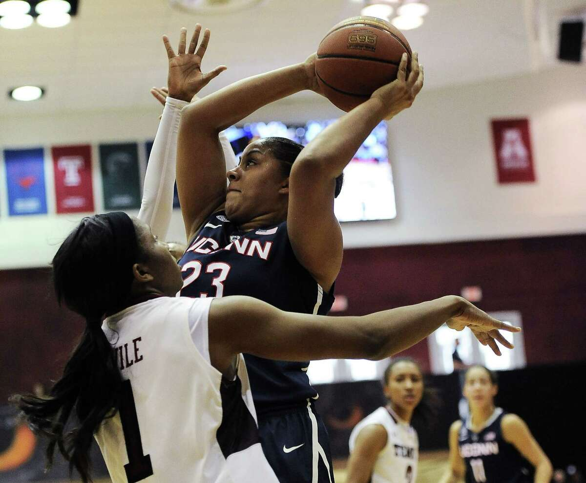 UConn's Kaleena Mosqueda-Lewis (23) looks for room to shoot over Temple's Erica Covile during the first half Sunday in Philadelphia.