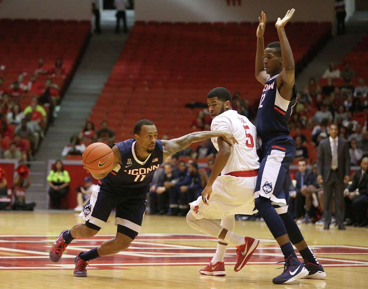 UConn's Ryan Boatright (11) dribbles around Houston guard L.J. Rose while Kentan Facey sets a pick in the first half Sunday.